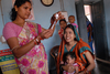 Community health worker gives a vaccination in Odisha state, India